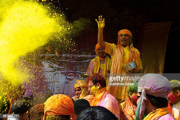 Colouredpowders are thrown by priests on the devotees who have gathered at the Krishna temple in Nandgaon Barsana a village near Mathura in Uttar...
