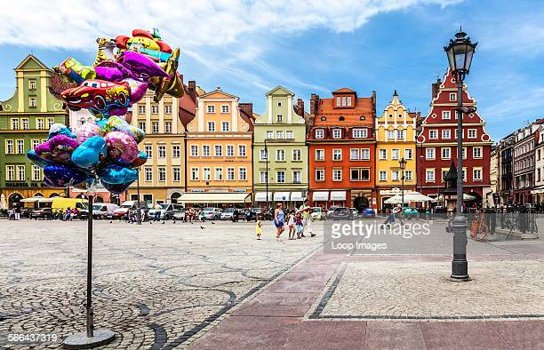 Colourful Baroque house facades and tourist balloons in Wroclaw's old town Market Square or Rynek