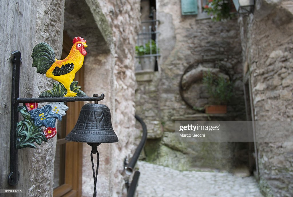 A colourful bell hangs outside one of the few lived-in houses in the village of Casso on September 28, 2013 in Longarone, Italy. The Vajont Dam tragedy happened on the night of the October 9, 1963, when a landslide broke away from Monte Toc and fell into the Vajont River, causing a wave that struck the neighboring towns and killing more than 2000 people.