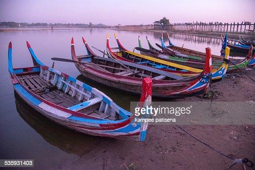 Colourful boat and U Bein Bridge : Stock Photo
