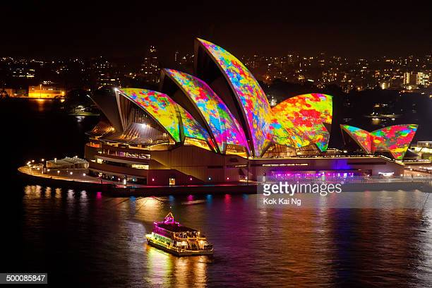 CONTENT] A colourful boat sails near the Sydney Opera House as colourful splotches of paint are projected on its sails as part of the Vivid Sydney...