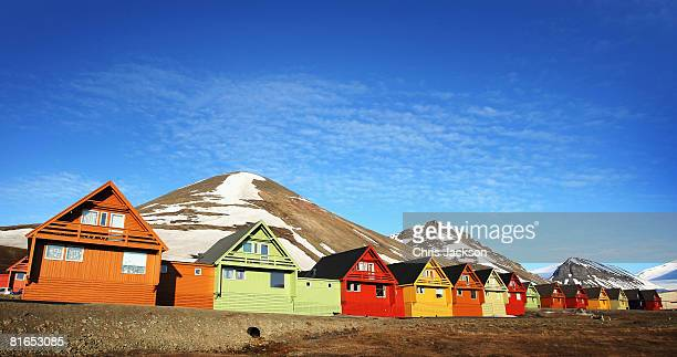 Colourful cabins reflect the midnight sun in the early morning of Midsummer on June 21 2008 in Longyearbyen Norway Longyearbyen is the seat of...
