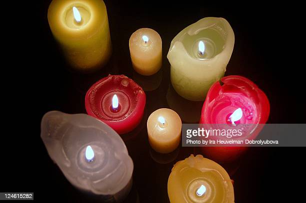 Colourful candles lit on dark background