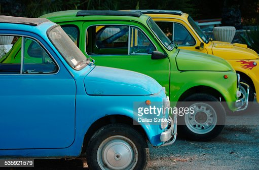 Colourful cars parked in a row, Lipari : Stock Photo