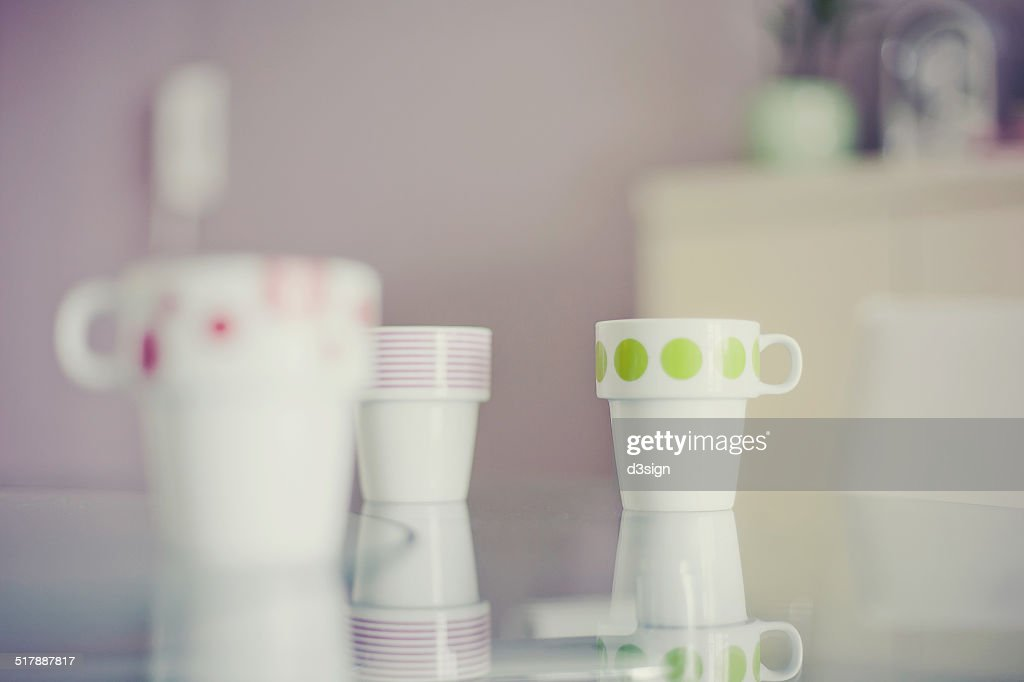 Colourful cups in cozy home