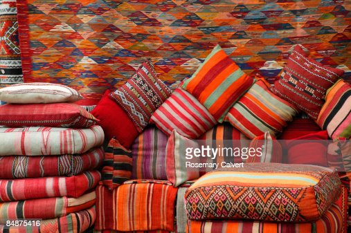 Colourful cushions and carpets in street market. : Stock Photo