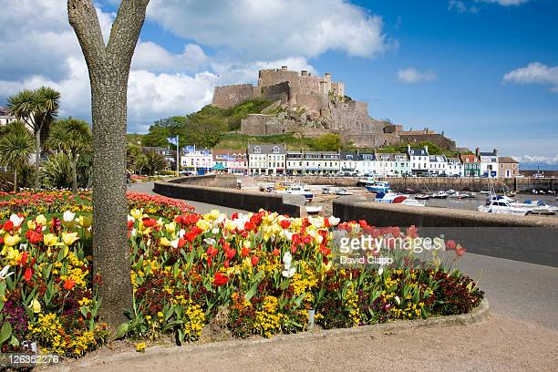 A colourful display of spring tulips on the promenade at Gorey leading towards the harbour and Mont Orgueil castle.
