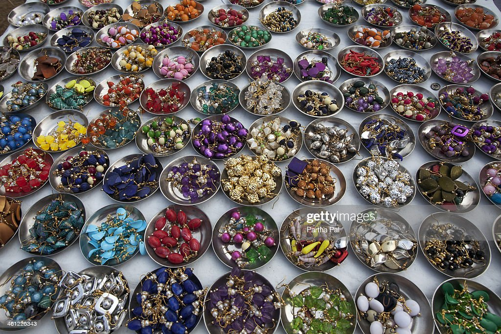 Colourful earrings for sell in a fair : Stock Photo