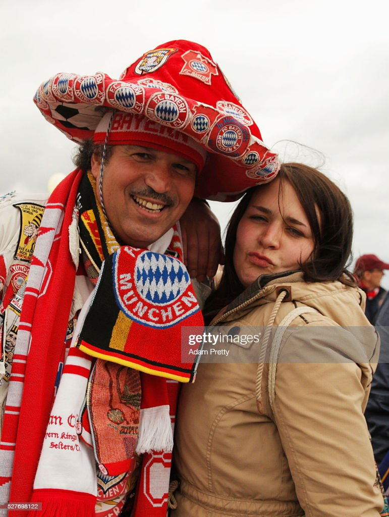 A colourful fan poses with a fellow supporter prior to UEFA Champions League semi final second leg match between FC Bayern Muenchen and Club Atletico de Madrid at Allianz Arena on May 3, 2016 in Munich, Germany.