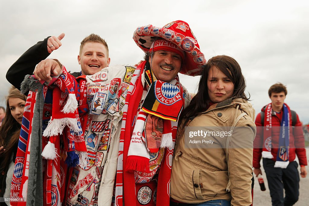 A colourful fan poses with fellow supporters prior to UEFA Champions League semi final second leg match between FC Bayern Muenchen and Club Atletico de Madrid at Allianz Arena on May 3, 2016 in Munich, Germany.