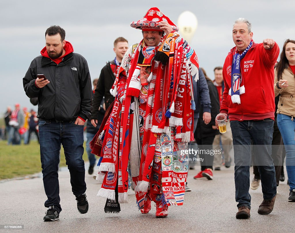 A colourful fan walks towards the ground with fellow supporters prior to UEFA Champions League semi final second leg match between FC Bayern Muenchen and Club Atletico de Madrid at Allianz Arena on May 3, 2016 in Munich, Germany.
