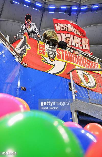Colourful fans of Cologne during the Bundesliga match between Hamburger SV and 1 FC Koeln at Volksparkstadion on February 7 2016 in Hamburg Germany