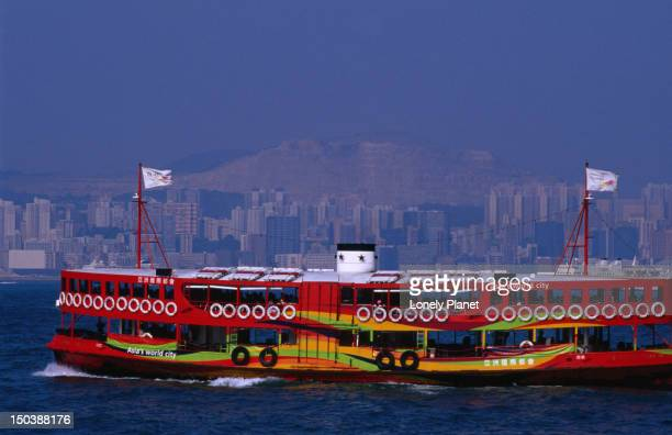 Colourful ferry makes its way across to Tsim Sha Tsui from the Wan Chai terminal.
