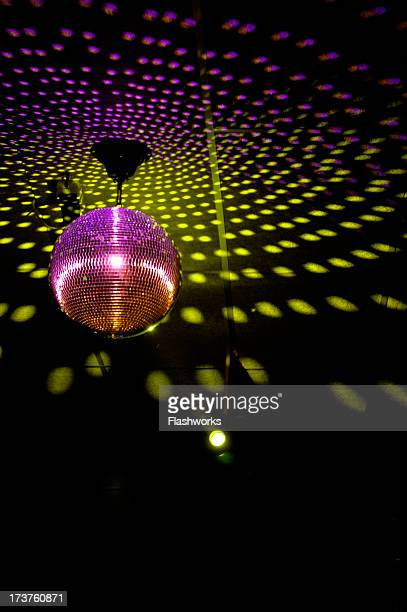 Colourful glitter mirrorball in disco 3