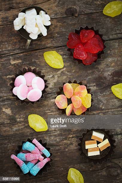 Colourful gummy candies in vintage baking trays