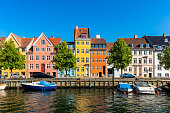 Colourful houses along canal in Downtown District of Copenhagen, Denmark.