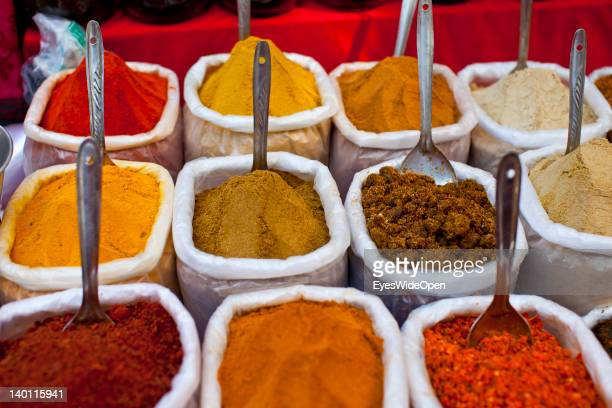 Colourful Indian spices are sold at a market in Anjuna on February 1 2012 in Goa India