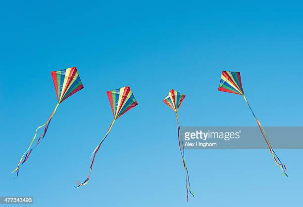 Colourful kites flying in a blue sky