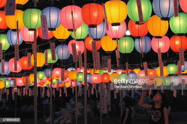 Colourful lanterns are hung to celebrate the Bon holiday at Sekiozennji Temple on August 12 2011 in Kamaishi Iwate Japan 'Bon' or 'Obon' is a...
