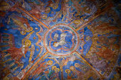 Colourful medieval painting on the ceiling of the main nave in Braunschweig Cathedral, with the peaceful sheep of Jesus in the centre.