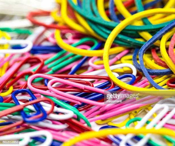 Colourful Paper Clips and rubber bands On white Background