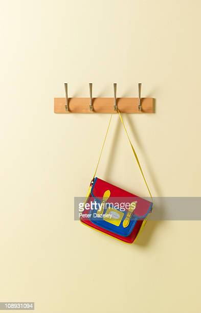 Colourful school satchel on coat rack