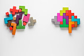 The concept of rational and irrational thinking. Colourful shapes of abstract brain for concept of idea and teamwork. Different thinking. Creative business concept.