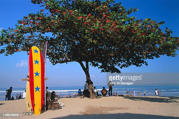 Colourful surfboards wait for tourists on Kuta in Bali.