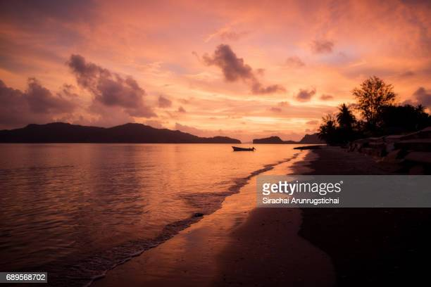 Colourful twilight sky at sunset over empty tropical beach