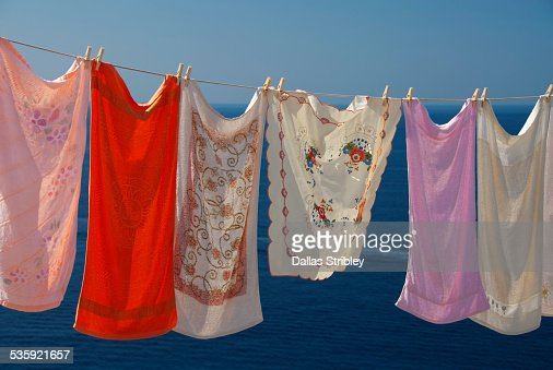 Colourful washing drying on the island of Lipari : Stock Photo