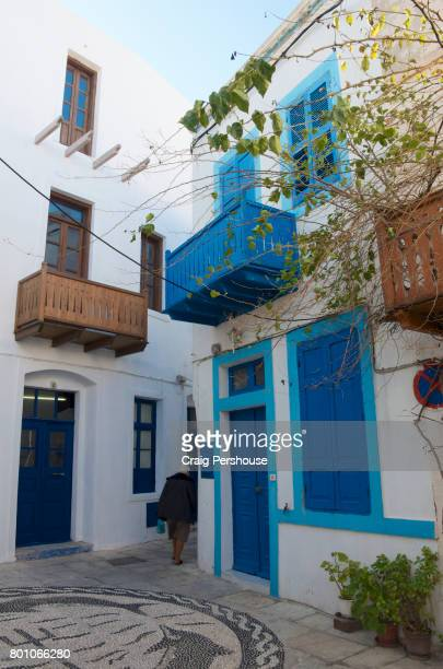 Colourful whitewashed houses in small square.