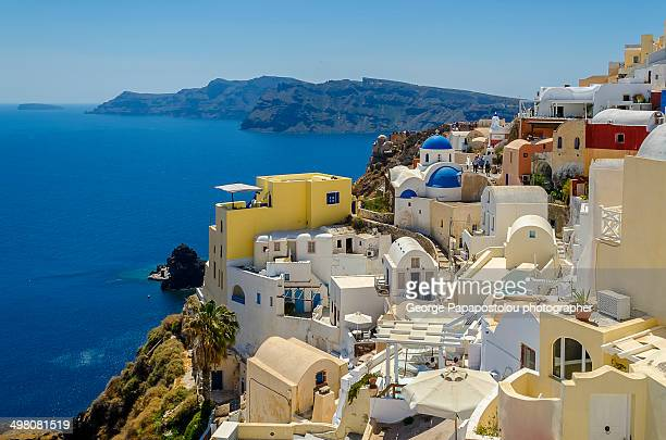 Colourfull houses and church whit blue dome in Oia