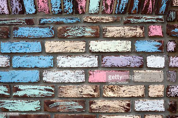 Colourfully chalked brick wall