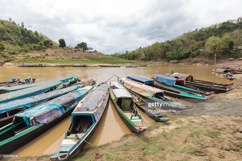 Colourfully painted fishing boats on Sangu River, Chittagong Hill Tracts, Bangladesh