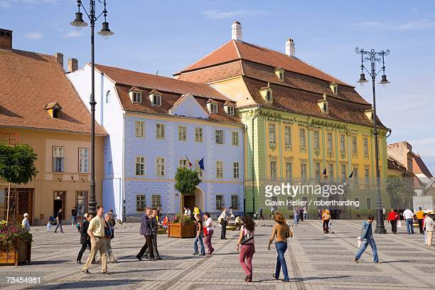 Colourfully painted houses and buildings surrounding the main old town square, Piata Mare, in the 12th century Saxon city, Sibiu, Transylvania, Romania, Europe