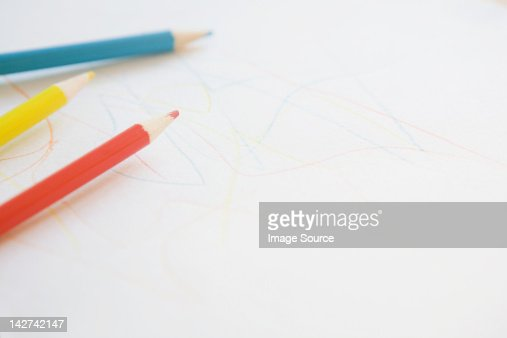 Colouring pencils and child's drawing