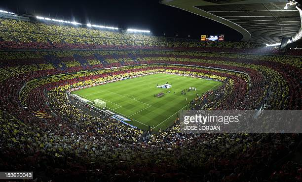 Colours of Catalonia are displayed by football fans ahead of the Spanish League Clasico football match FC Barcelona vs Real Madrid CF on October 7...