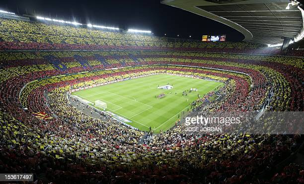 Colours of Catalunya are displayed by football fans ahead of the Spanish League Clasico football match FC Barcelona vs Real Madrid CF on October 7...