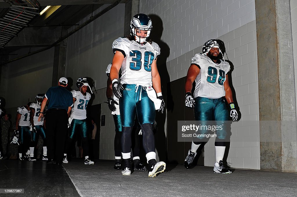 Colt Anderson and Mike Patterson of the Philadelphia Eagles head to the field to play against the Atlanta Falcons at the Georgia Dome on September 18...
