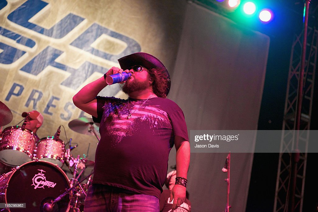 <a gi-track='captionPersonalityLinkClicked' href=/galleries/search?phrase=Colt+Ford&family=editorial&specificpeople=5348774 ng-click='$event.stopPropagation()'>Colt Ford</a> performs during Bud Light Music First 50/50/1 on August 1, 2013 in Nashville, Tennessee.