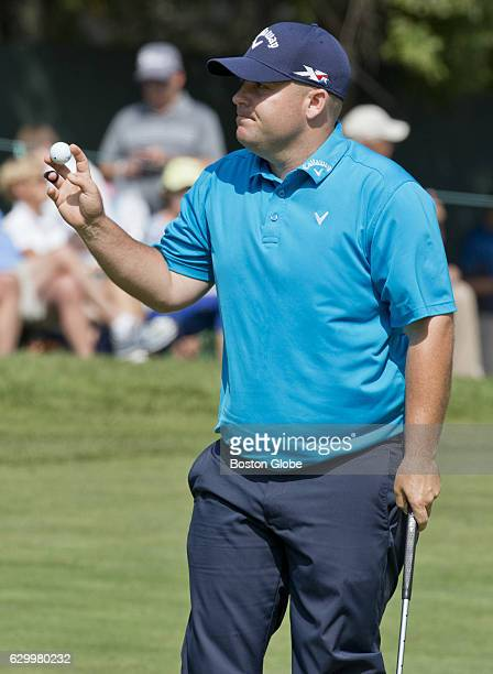 Colt Knost holds up the ball after finishing his round 4 on the 9th hole during the firstround action at the Deutsche Bank Championship at TPC Boston...