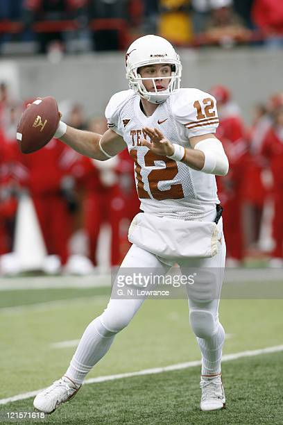 Colt McCoy of Texas attempts to pass during action between the Texas Longhorns and Nebraska Cornhuskers on October 21 2006 at Memorial Stadium in...