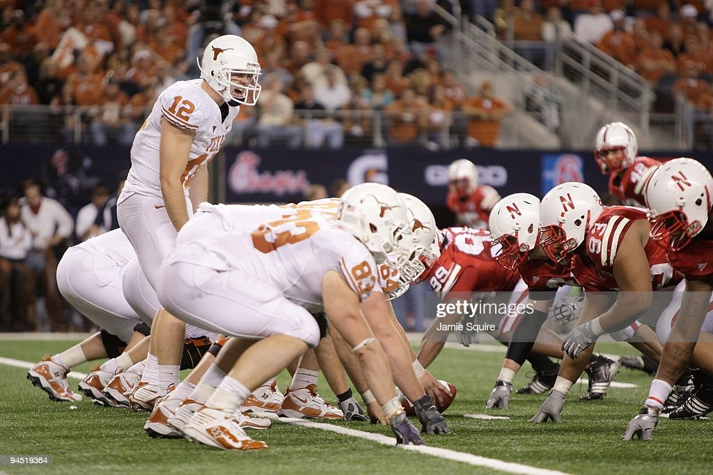 ... Colt McCoy 12 of the Texas Longhorns calls the play at the line of  scrimmage Mens medium texas longhorns colt mccoy 12 nike team sewn jersey  ... ad5702b65