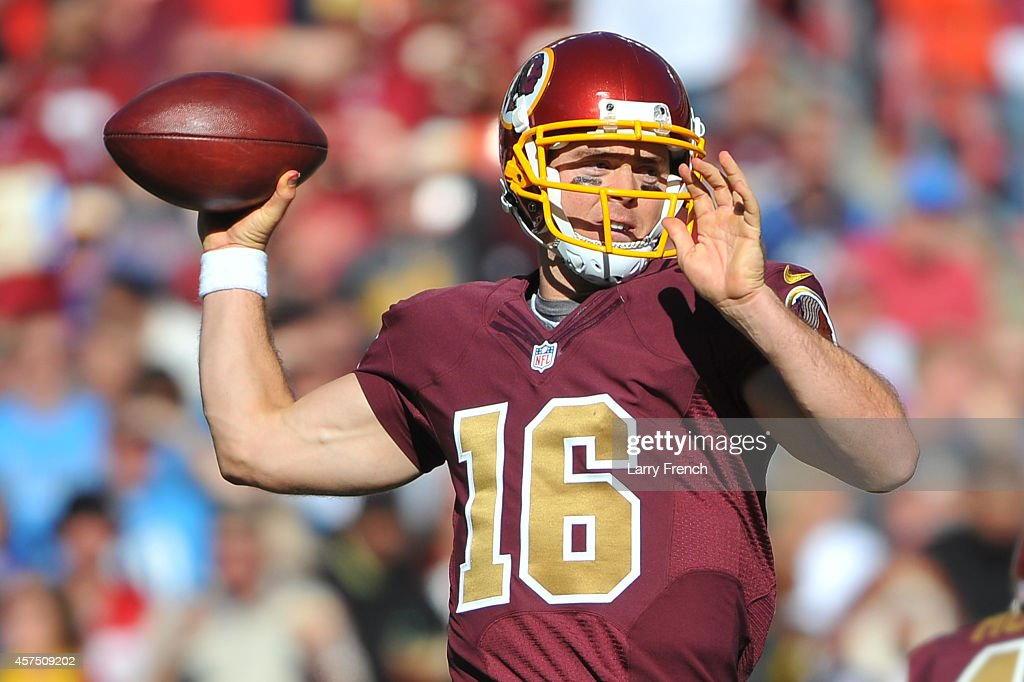Colt McCoy #16 of the Washington Redskins looks to pass against the Tennessee Titans during third quarter at FedEx Field on October 19, 2014 in Landover, Maryland.