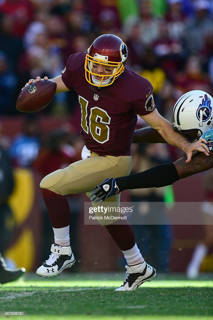 Colt McCoy #16 of the Washington Redskins scrambles during the fourth quarter against the Tennessee Titans at FedEx Field on October 19, 2014 in Landover, Maryland.