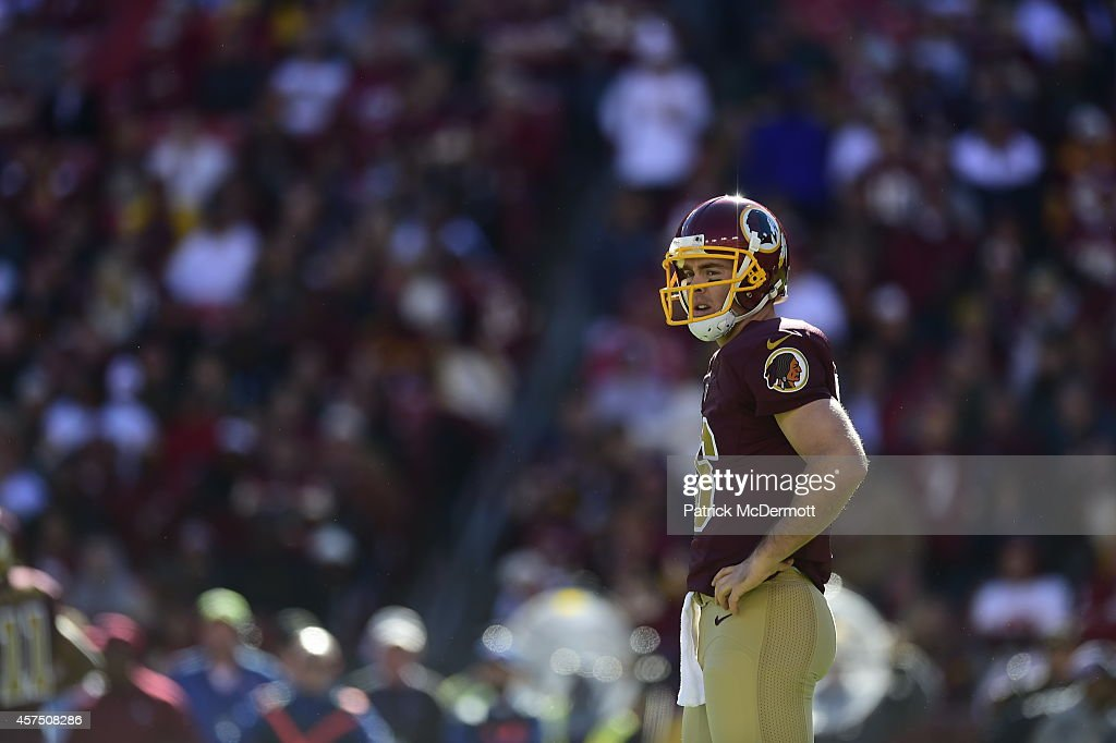 Colt McCoy #16 of the Washington Redskins waits for a play to signaled during a game against the Tennessee Titans at FedEx Field on October 19, 2014 in Landover, Maryland.