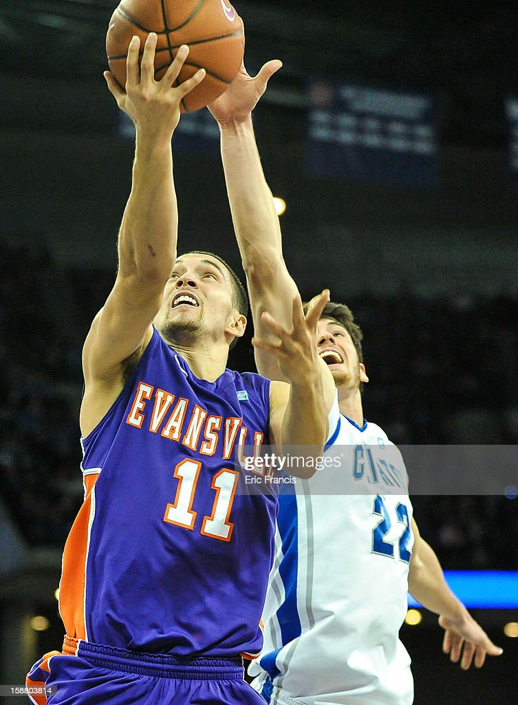 Colt Ryan #11 of the Evansville Aces lays the ball in past Will Artino #31 of the Creighton Bluejays during their game at the CenturyLink Center on December 29, 2012 in Omaha, Nebraska.