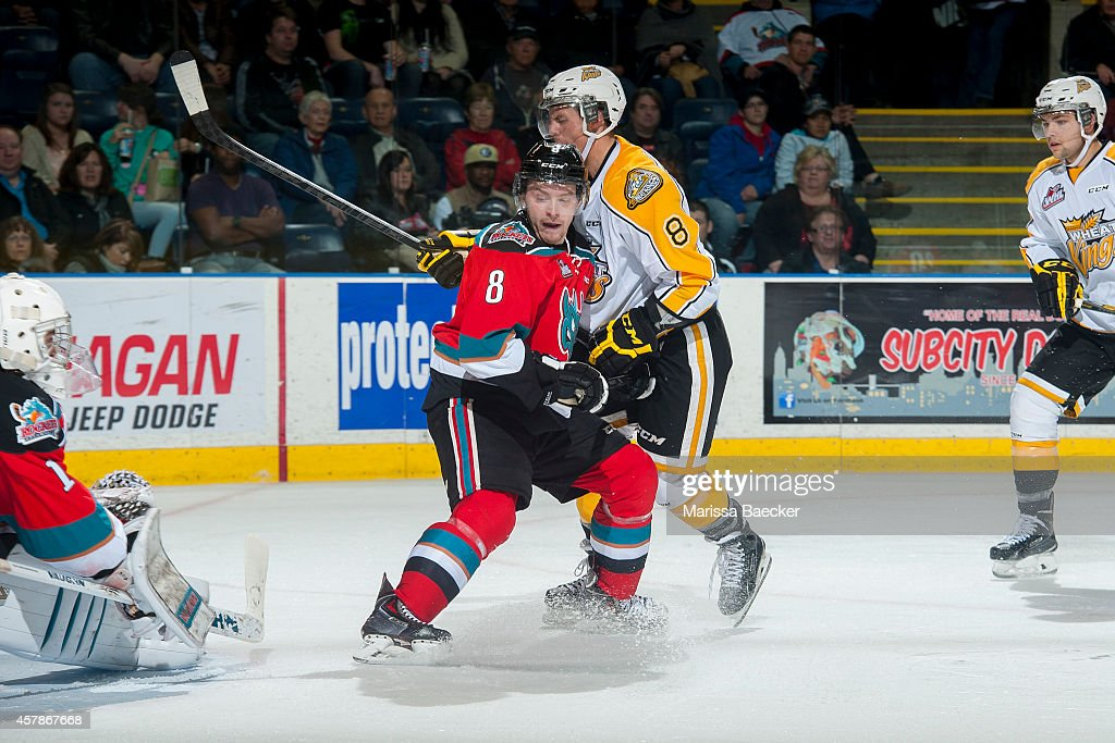 Colten Martin #8 of Kelowna Rockets checks Jayce Hawryluk #8 of Brandon Wheat Kings in front of the Rockets' net during second period on October 25, 2014 at Prospera Place in Kelowna, British Columbia, Canada.