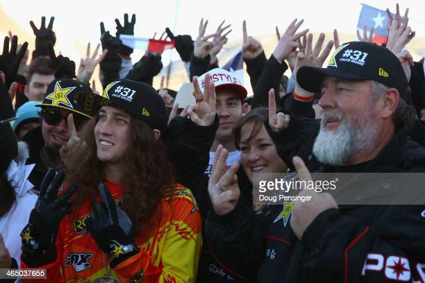 Colten Moore brother Michele Moore mother and Wade Moore of Caleb Moore along with friends salute with the at a memorial tribute during Winter XGames...