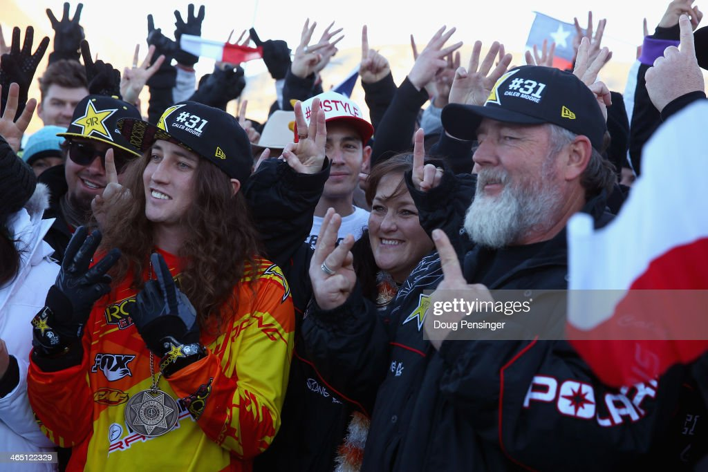 Colten Moore, brother, Michele Moore, mother and Wade Moore (father) of Caleb Moore along with friends salute with the #31 at a memorial tribute during Winter X-Games 2014 Aspen at Buttermilk Mountain on January 25, 2014 in Aspen, Colorado. Caleb Moore died as the result of injuries sustained during a snowmobile competition accident at Winter X-Games 2013 in Aspen.